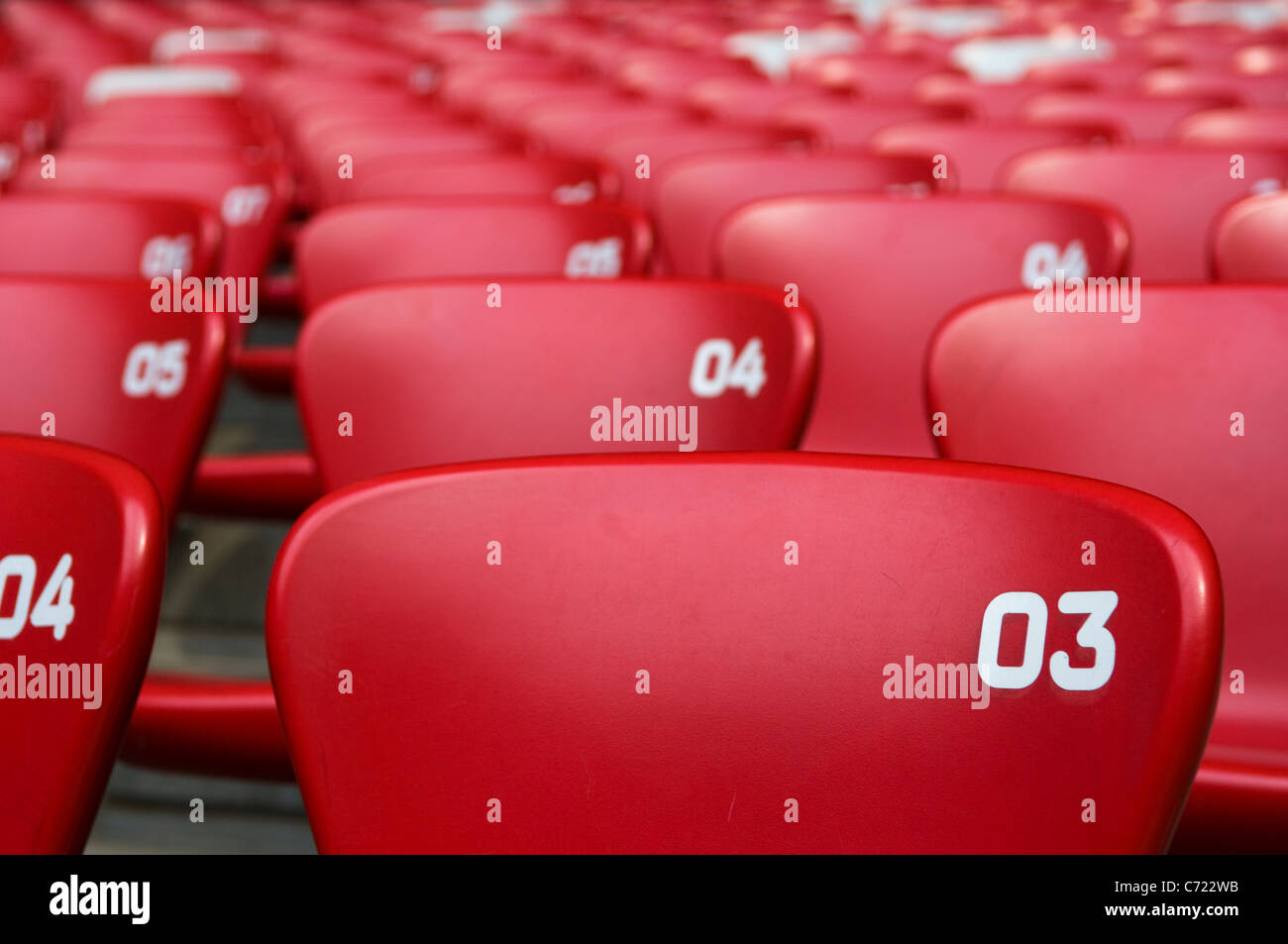 Red chairs at a stadium - Stock Image