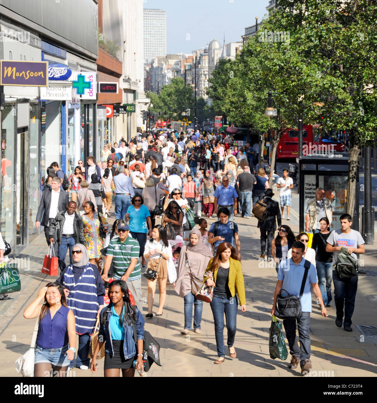 Shoppers in a busy Oxford Street - Stock Image