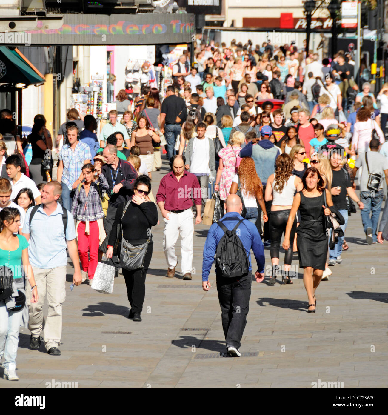 Busy street scene outside the Trocadero shopping complex London - Stock Image