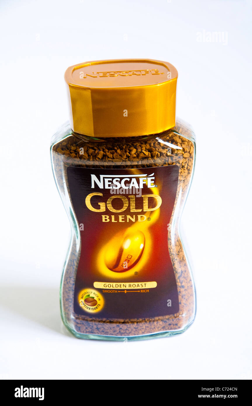 Nescafe Gold Blend instant coffee jar on a white background. - Stock Image