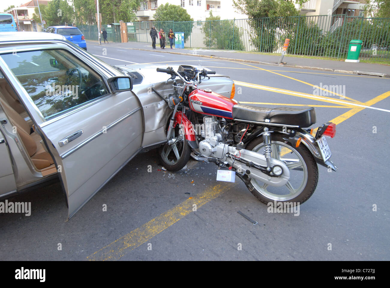 Accident between a car and motorcycle at an intersection on Main rd ...
