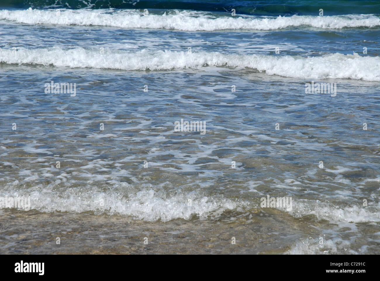 waves lapping beach, Florence Bay, Magnetic Island, Queensland, Australia - Stock Image