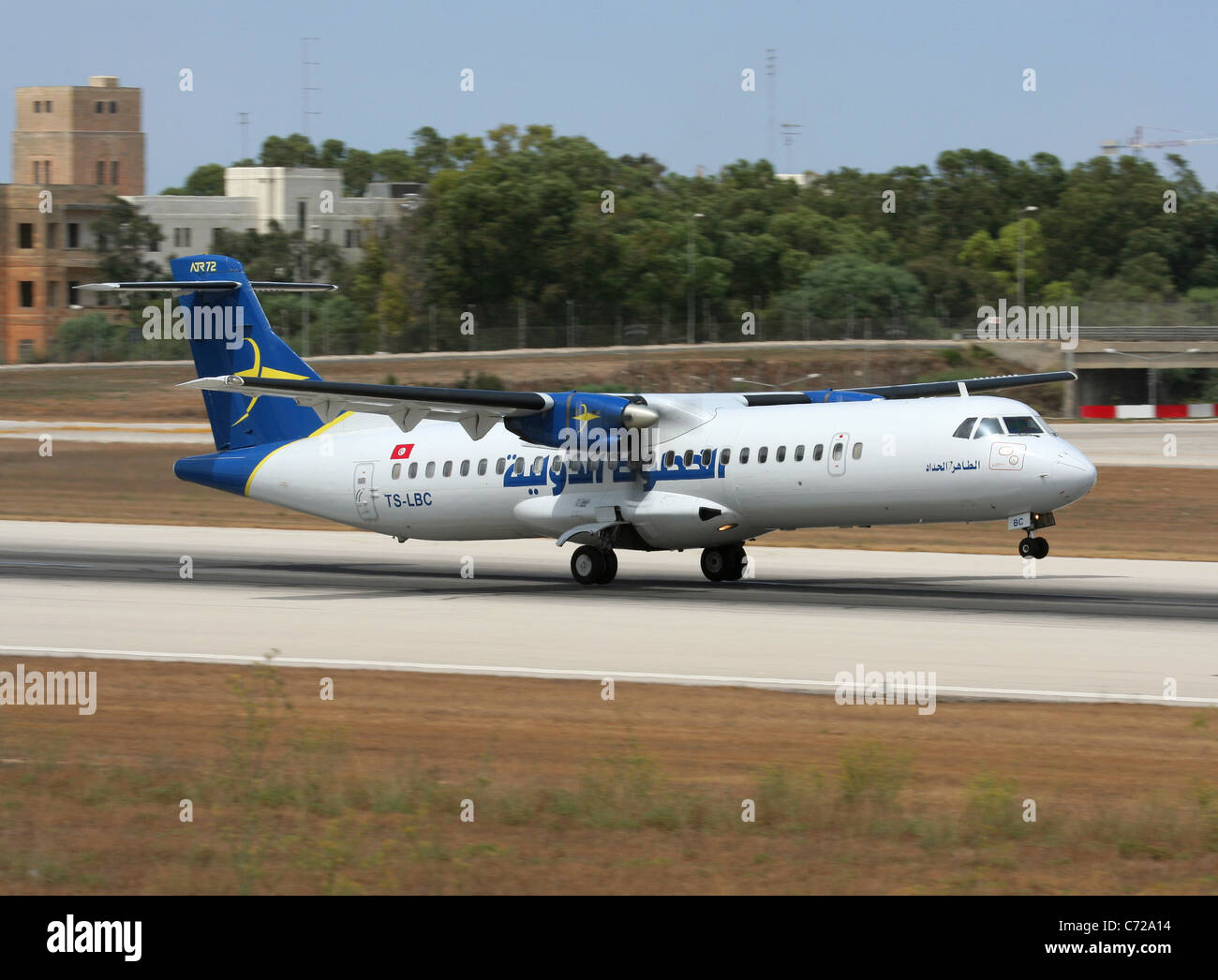 Tuninter ATR 72 short haul turboprop airliner taking off from Malta - Stock Image