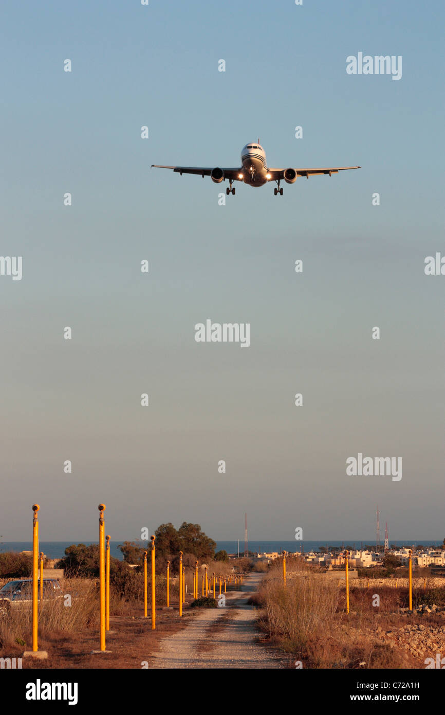 Front view of Airbus A319 passenger jet plane on flight path for landing - Stock Image