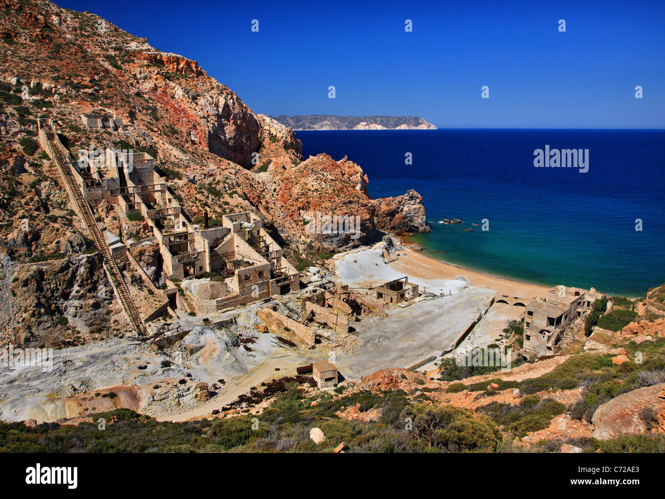 The abandoned sulfur mines and the beautiful beach with underwater hot springs in Milos island, Cyclades, Greece. - Stock Image