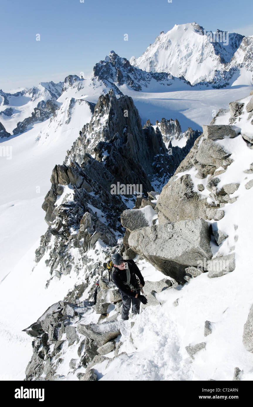 Alpinistes moving together on the Aiguille du Tour, Switzerland. - Stock Image