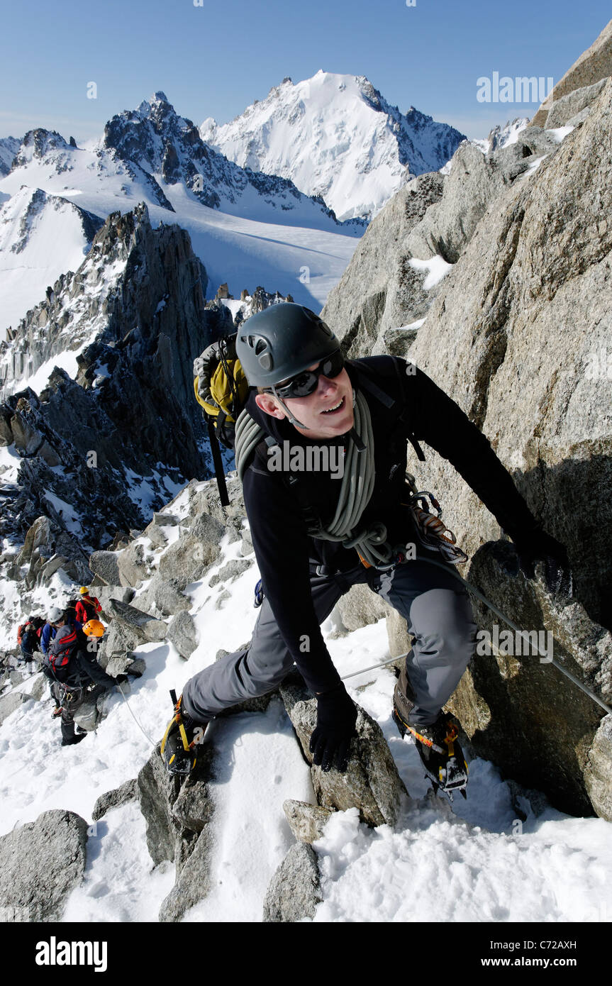 Alpinistes moving together on the Aiguille du Tour, Switzerland - Stock Image