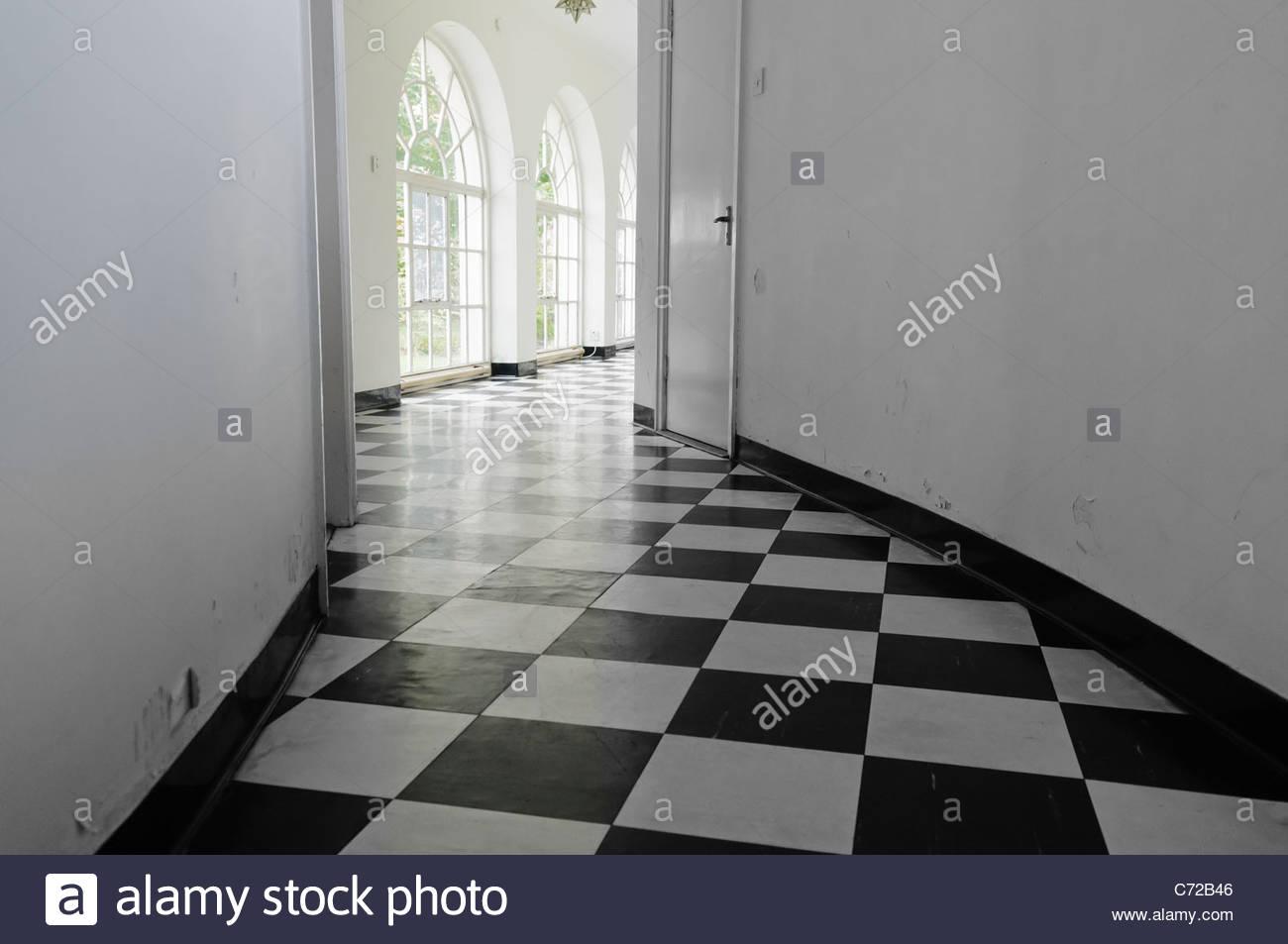 White art-deco hall with black and white floor tiles Stock Photo ...