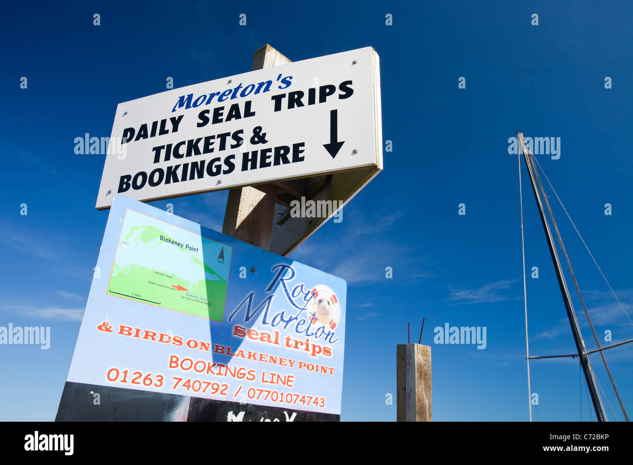 Adverts for seal watching trips from Blakeney Harbour, North Norfolk coast, UK. Stock Photo