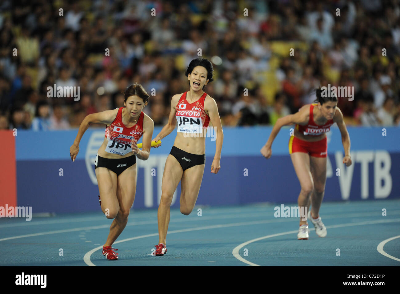 Saori Imai and  Chisato Fukushima (JPN) perform for the women's 4x100m relay heats at the 13th IAAF World Championships. - Stock Image