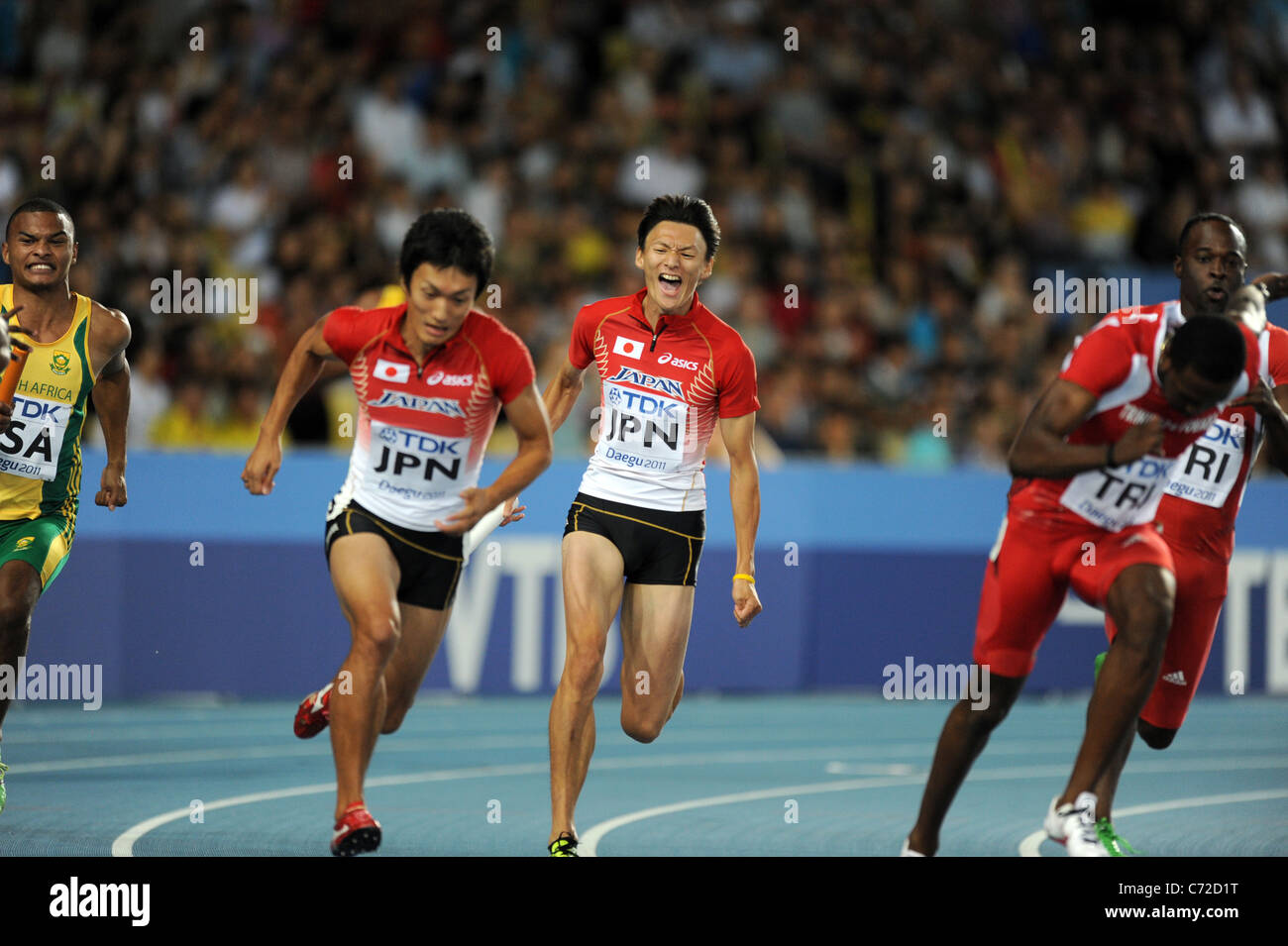 Hitoshi Saito and Shinji Takahira (JPN) perform for the men's 4x100m relay heats at the 13th IAAF World Championships. - Stock Image
