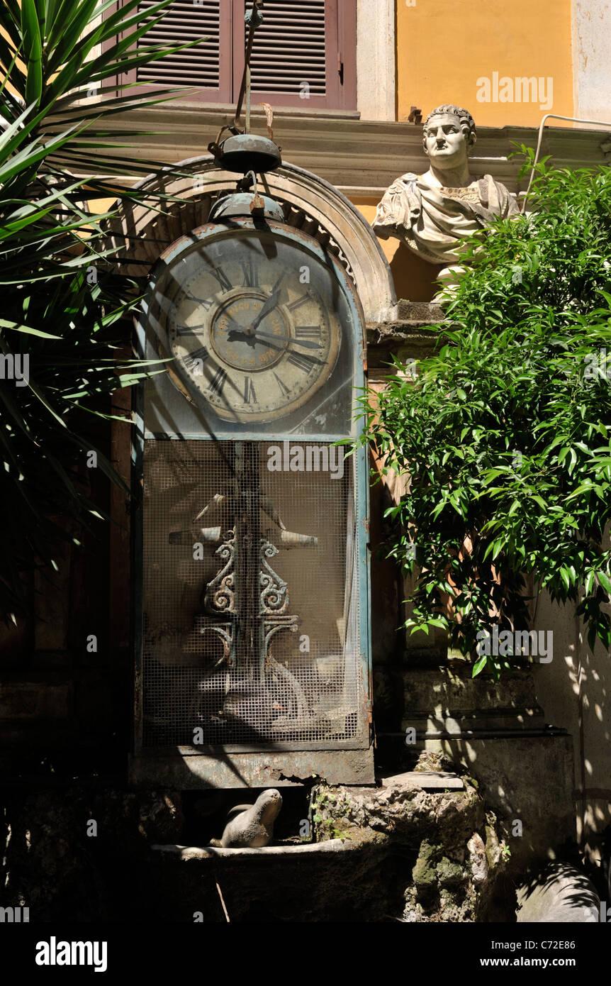 italy, rome, palazzo berardi, courtyard, ancient water clock - Stock Image