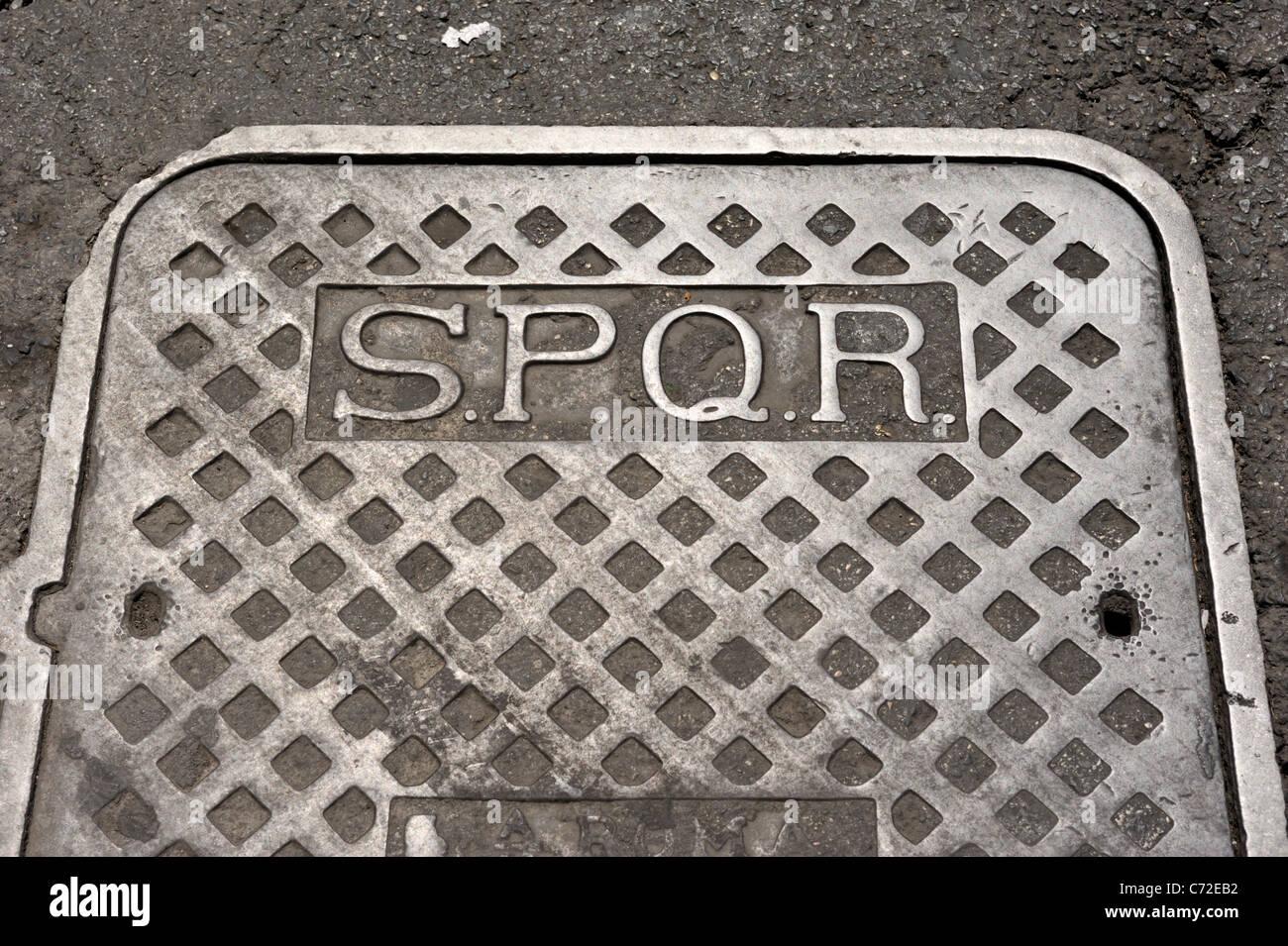 italy, rome, SPQR manhole cover - Stock Image