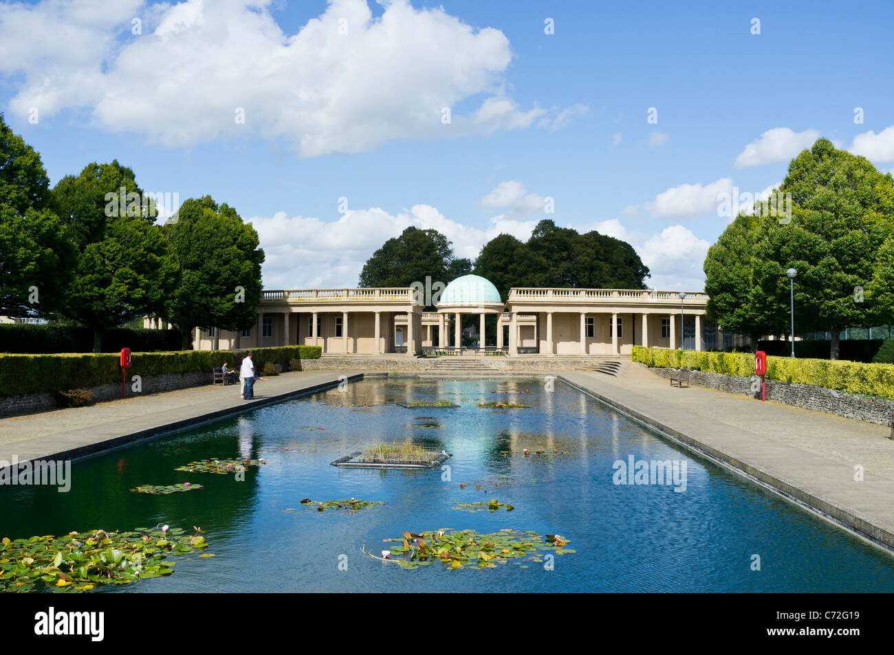 Lily pond Eaton Park Norwich, Norfolk with bandstand. - Stock Image