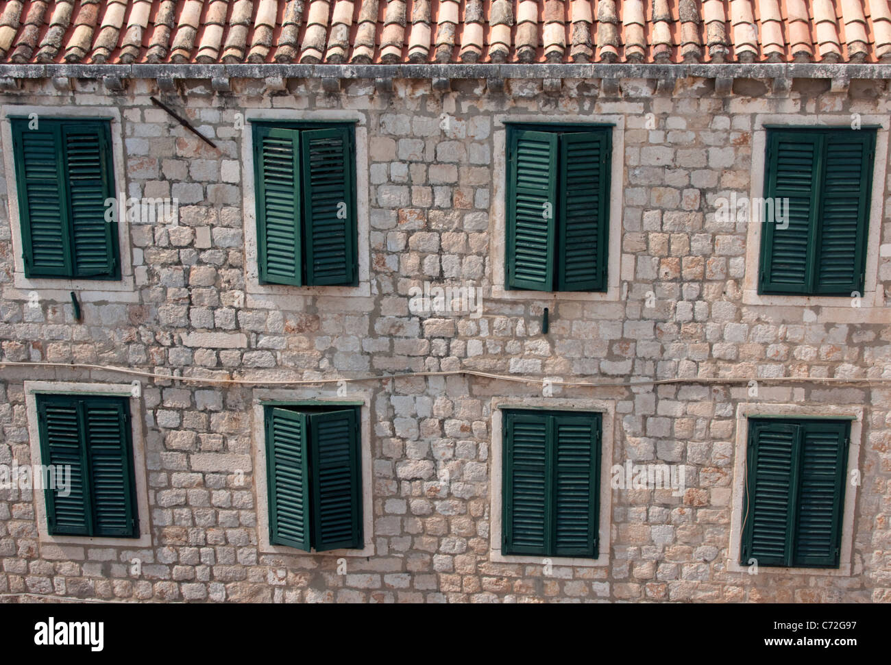 Shuttered windows - Stock Image