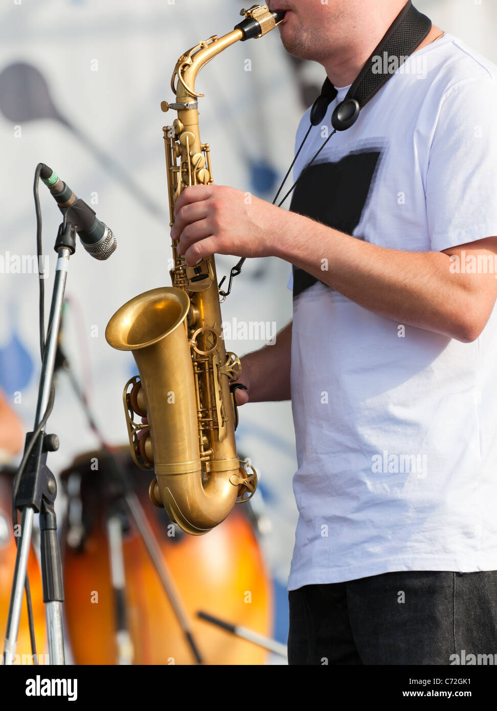 Man playing with saxophone on the concert - Stock Image