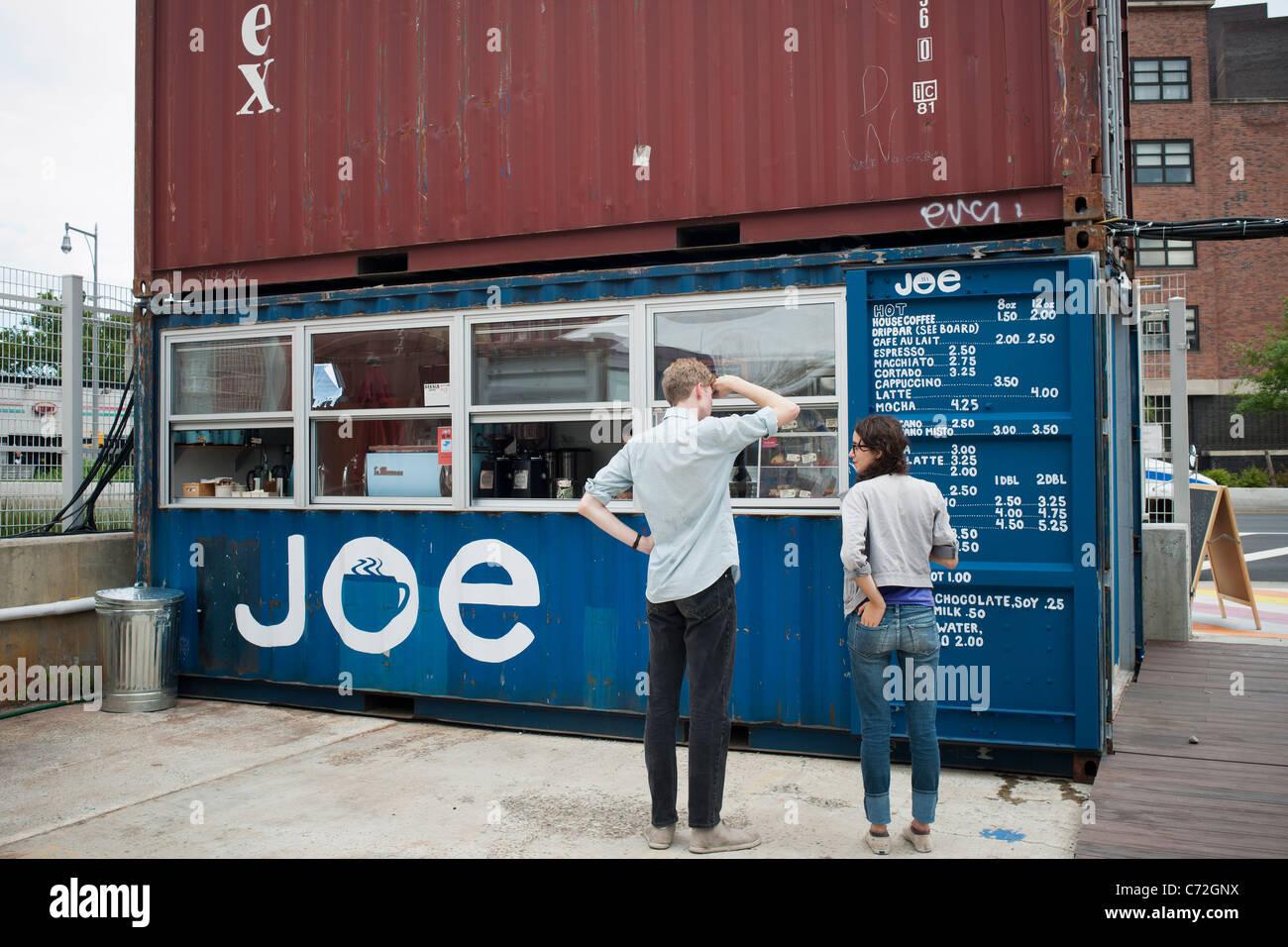 Customers peruse the menu at Joe, a coffee bar, in the Dekalb Market in downtown Brooklyn in New York - Stock Image