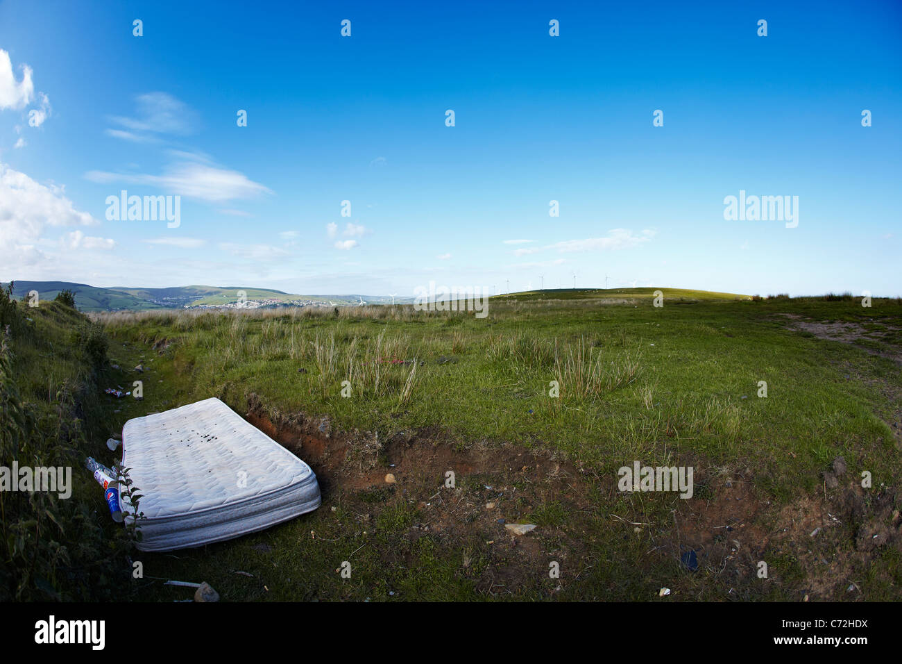 Old Mattress dumped by the side of the road, South Wales, UK - Stock Image