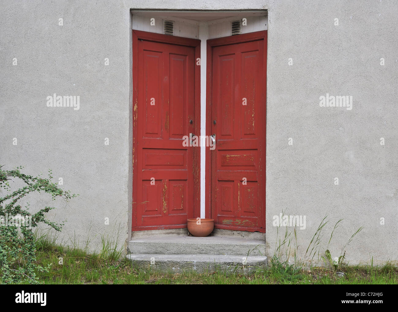 Two red doors equal - Stock Image