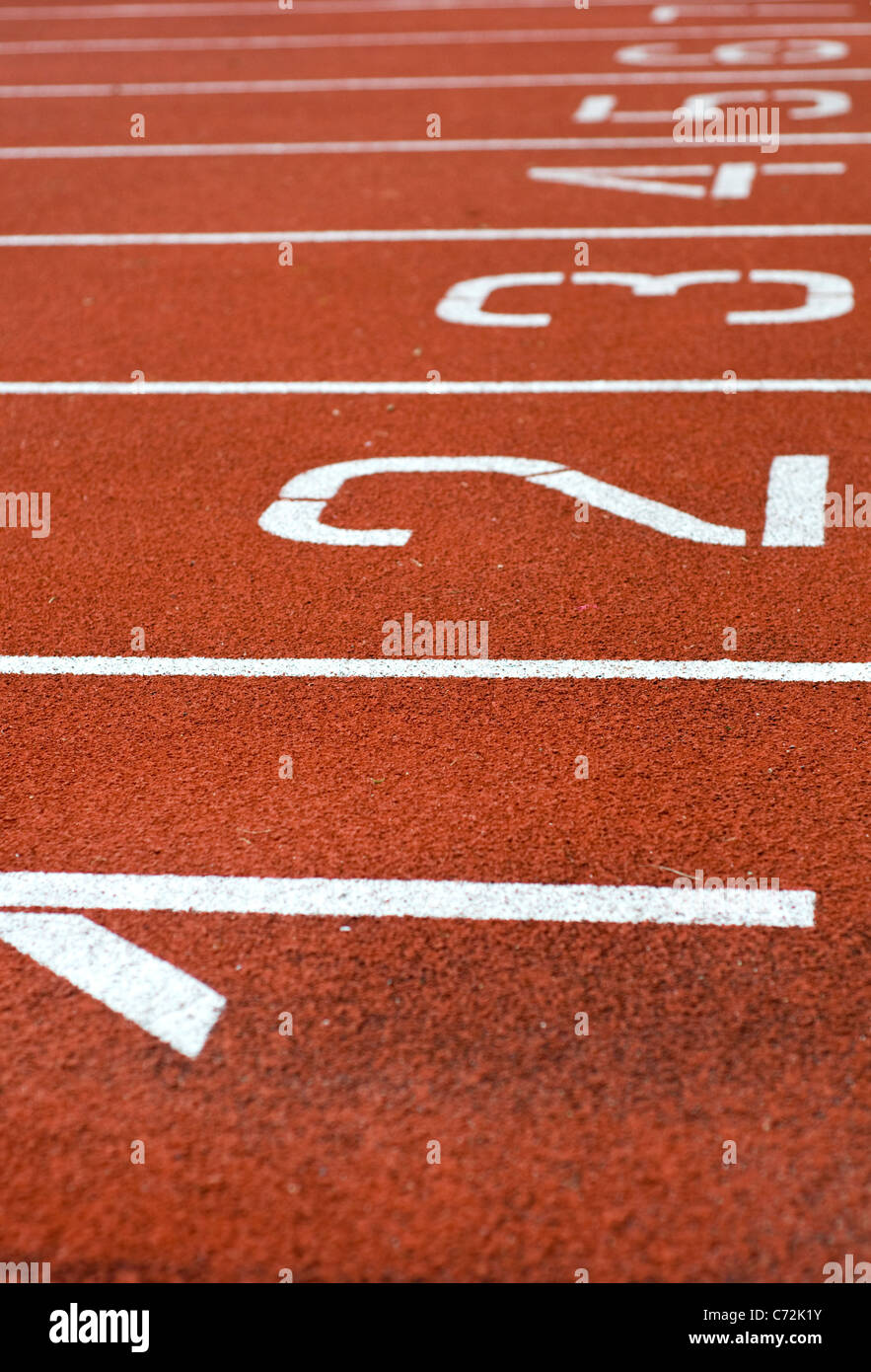 Close up of the lanes on an outdoor athletics track - Stock Image