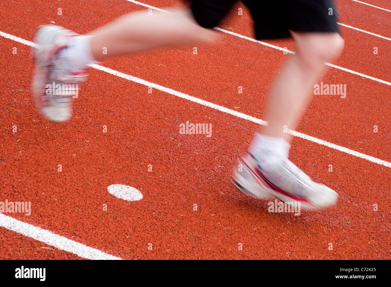 Detail of a runner on an athletics track - Stock Image