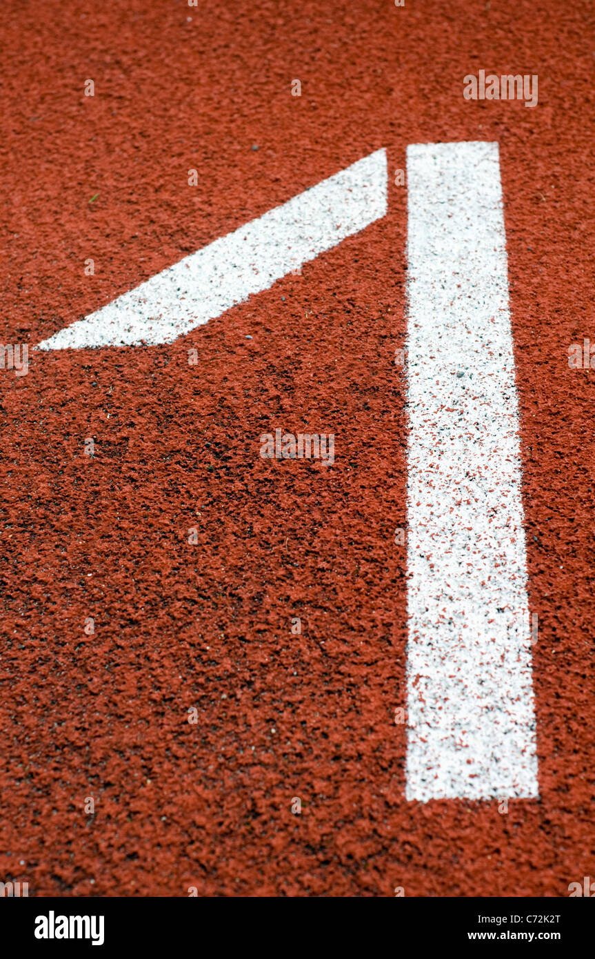 Close up of lane one on an outdoor athletics track - Stock Image