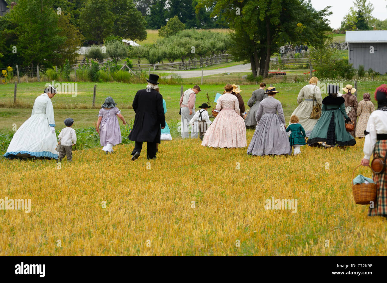 Group of people in period costume walking towards soldiers in reenactment of the Battle of Bull Run Milton Ontario - Stock Image