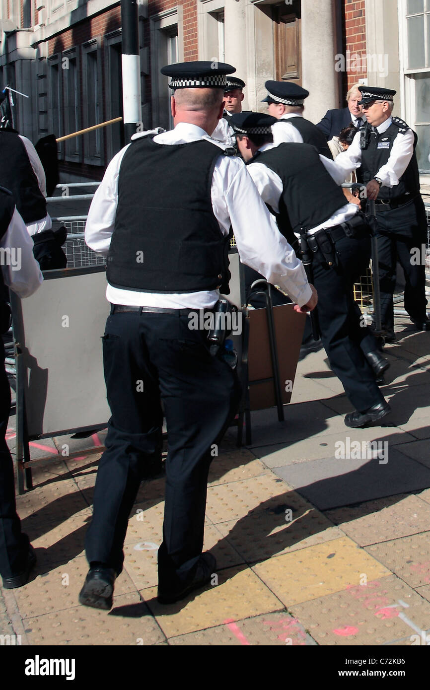 Police scuffle with protesters whilst protecting London Mayor Boris Johnson - Stock Image