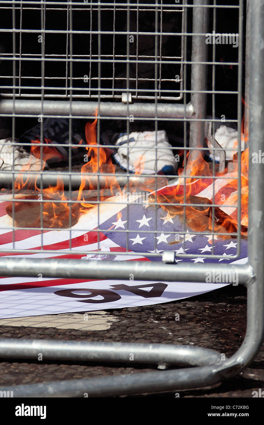 US Flag burnt outside the US Embassy in London. - Stock Image