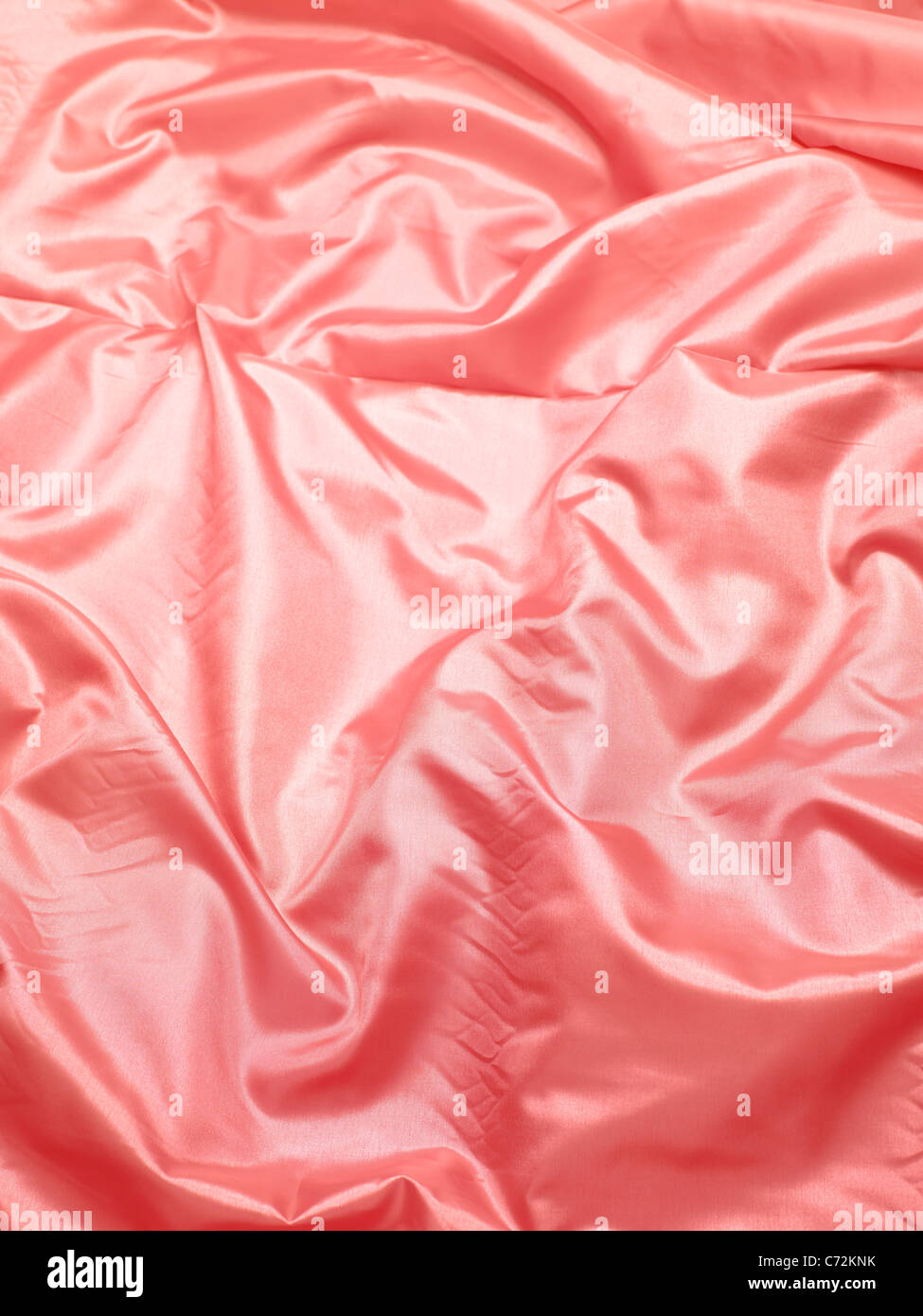 Pink silk bed sheet - Stock Image