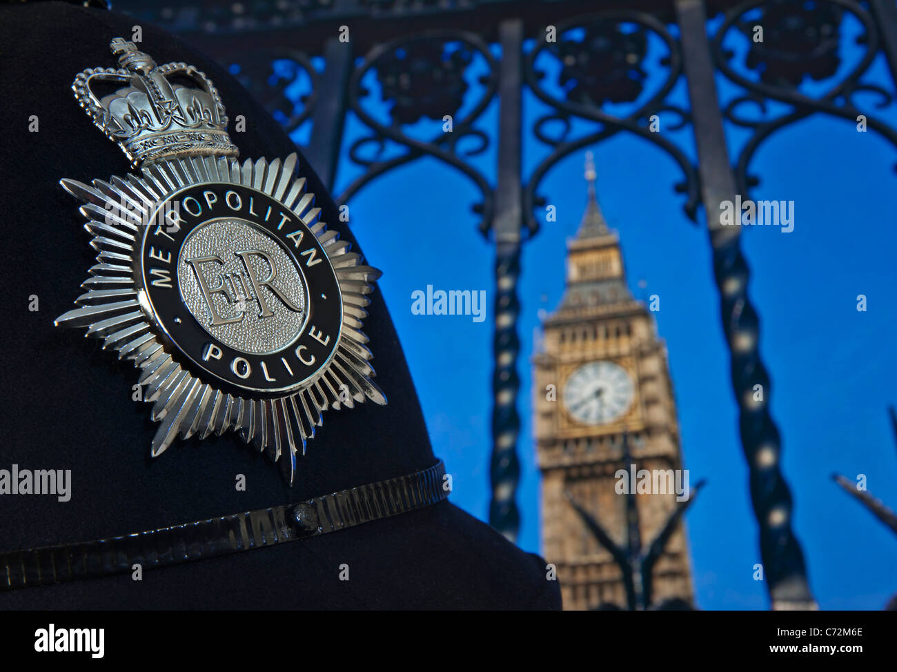 STOP & SEARCH Parliament London Metropolitan Police helmet badge outside Houses of Parliament on terrorism security - Stock Image