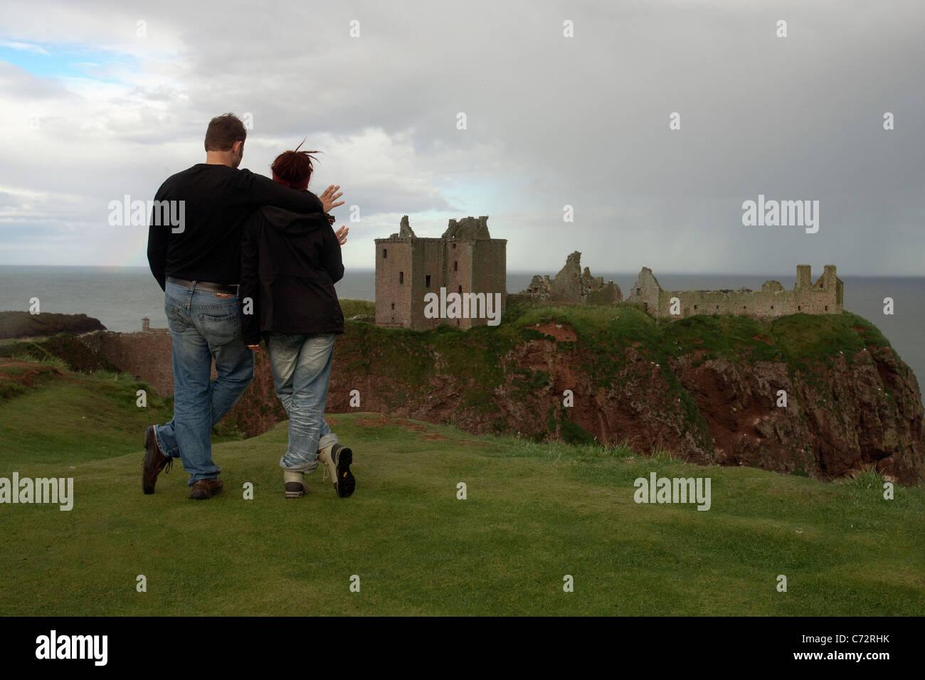 a couple at Dunnottar Castle stonehaven scotland - Stock Image