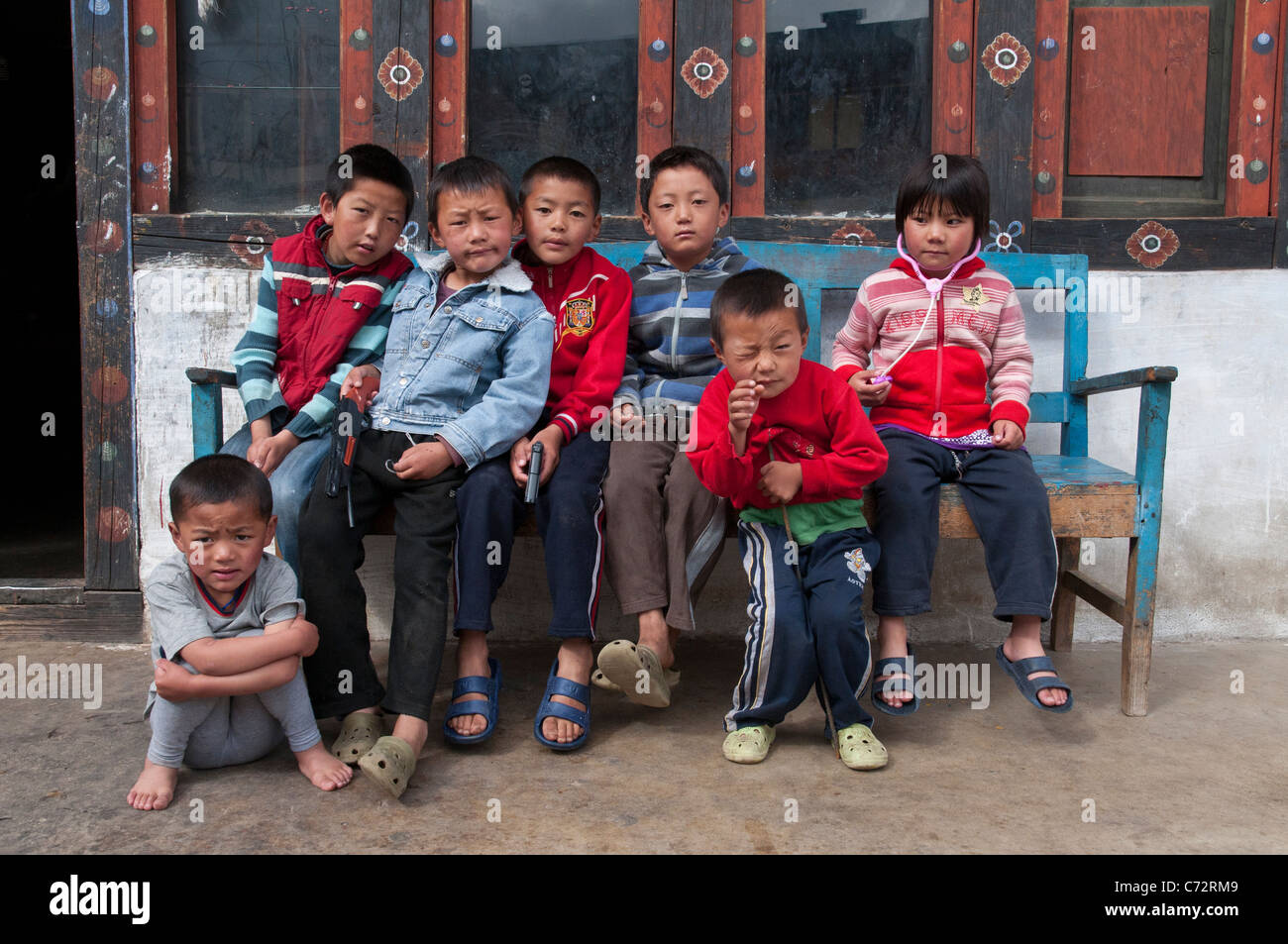 group of children pausing in front of traditional grocery. haa. Bhutan - Stock Image