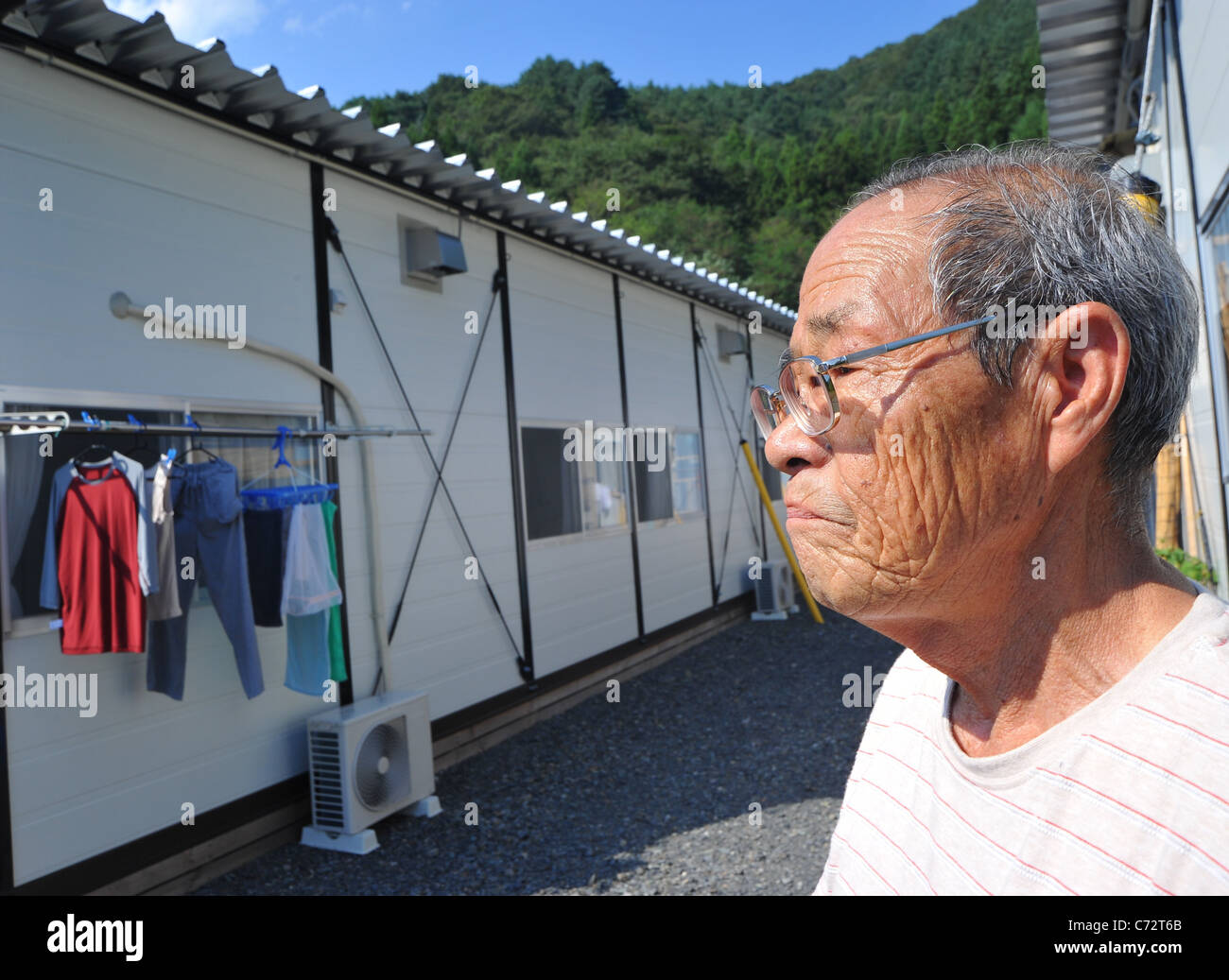 Minoru Ueno lives in a temporary housing nearly six months after the worst disaster Japan. - Stock Image