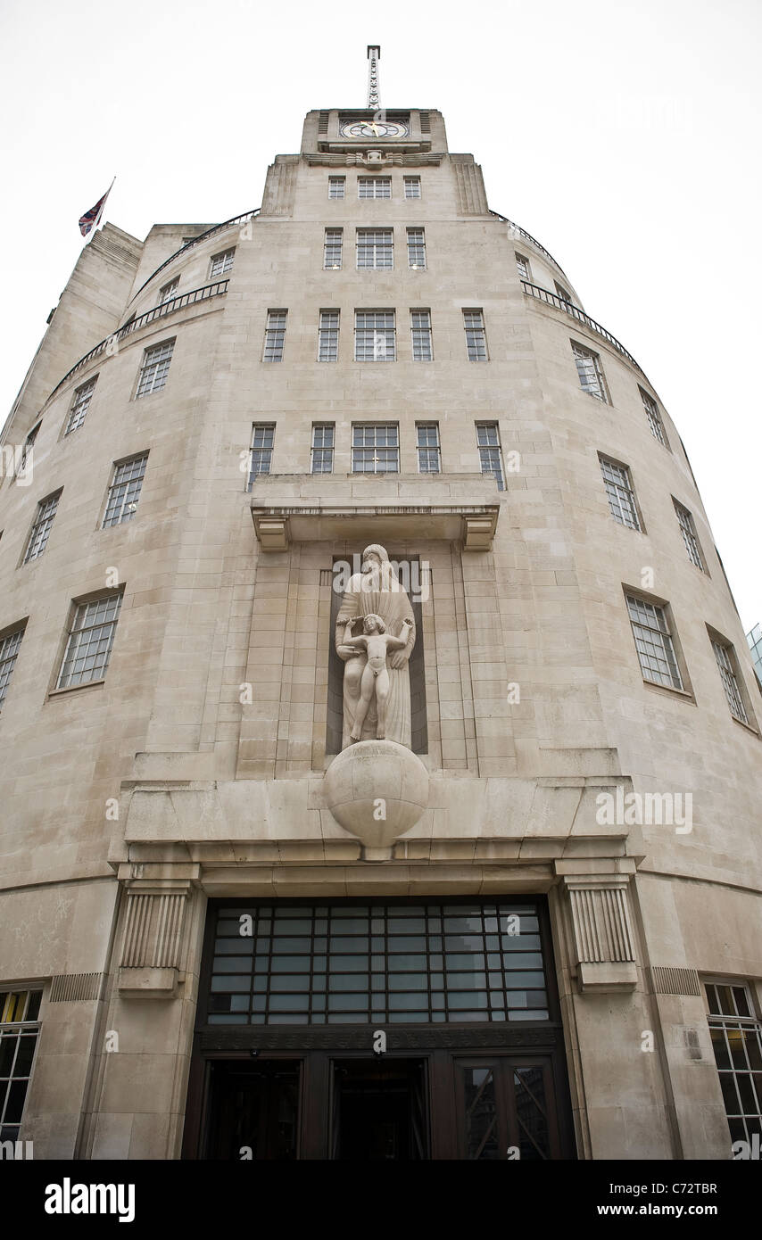 Eric Gill sculptures of Prospero and Ariel on the facade of BBC Broadcasting House, Portland Place, London, UK - Stock Image