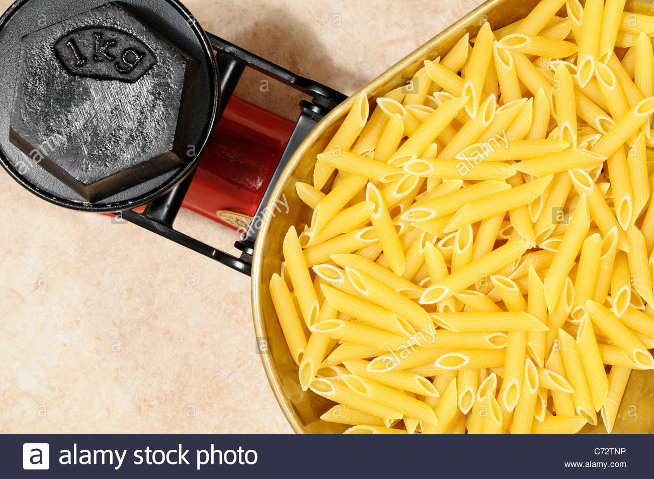 Dry pasta on Kitchen scales 1kg, England Stock Photo