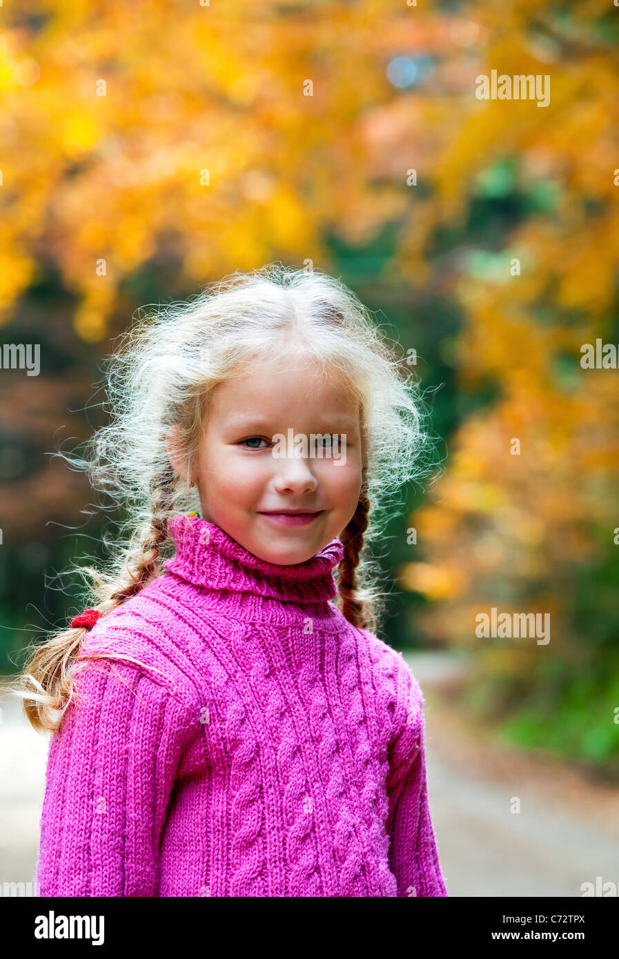Schoolage girl portrait in a autumn mountain walk - Stock Image