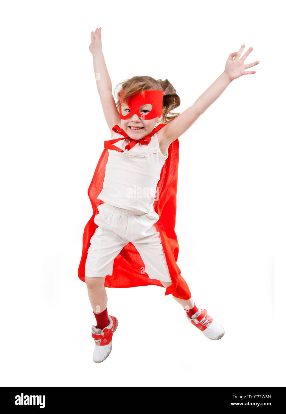 Superhero little girl in a red raincoat and a mask - Stock Image