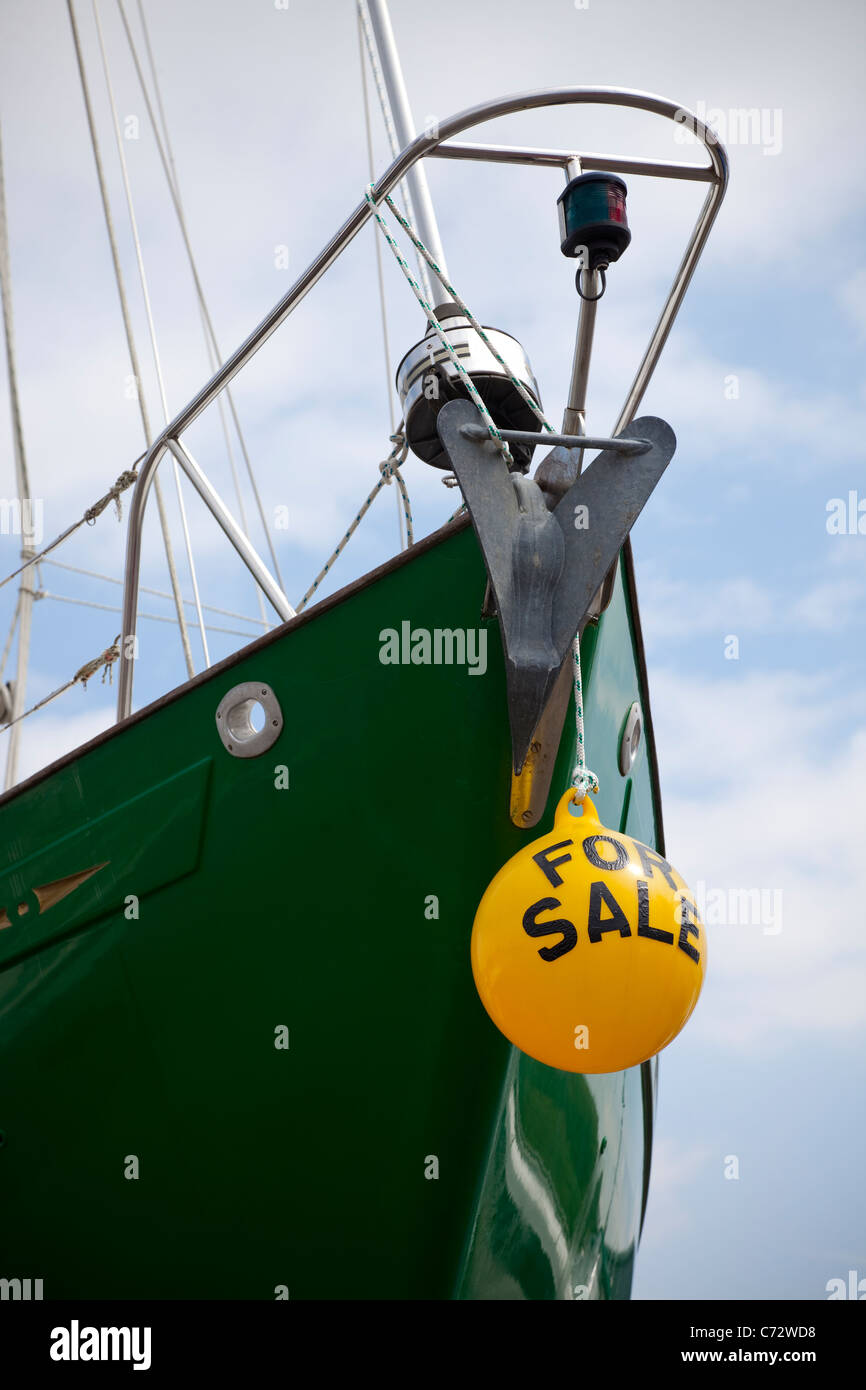 Green bow of a yacht with a yellow float indicating the boat is for sale, Largs, Ayrshire, Scotland, UK, Great Britain - Stock Image