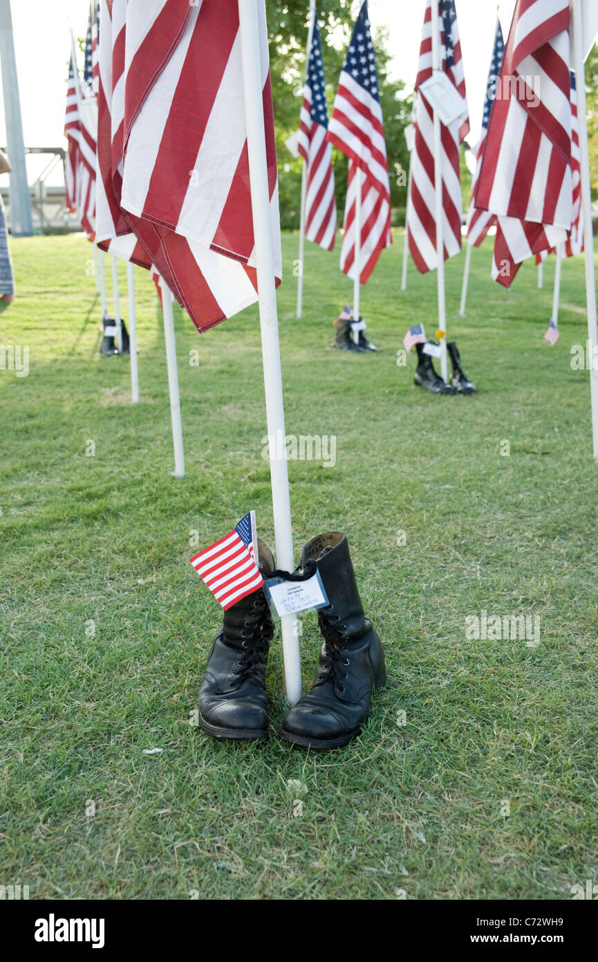 Boots at the foot of a flag at the September 11 Healing Field, Tempe, Arizona, USA - Stock Image