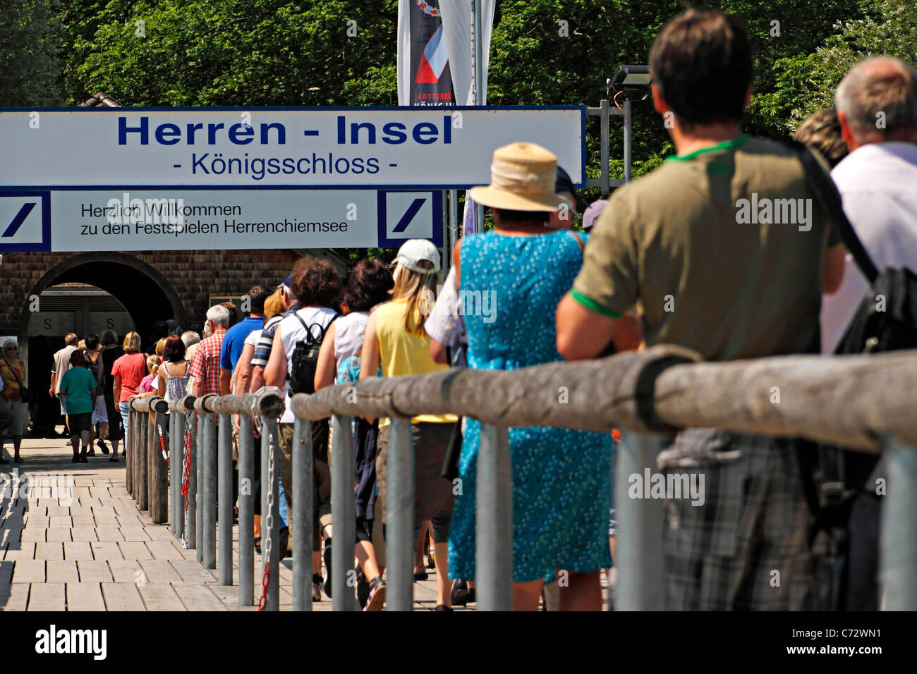 People on a wooden pier at the Herrenchiemsee, Herreninsel Upper Bavaria Germany - Stock Image
