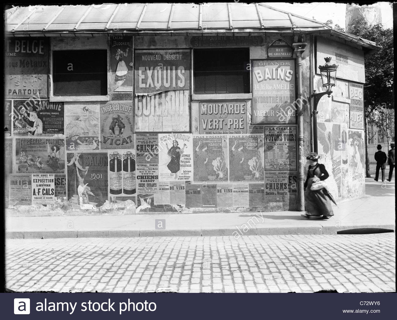 street posters on Rue de Grenelle, Paris France around 1900 - Stock Image