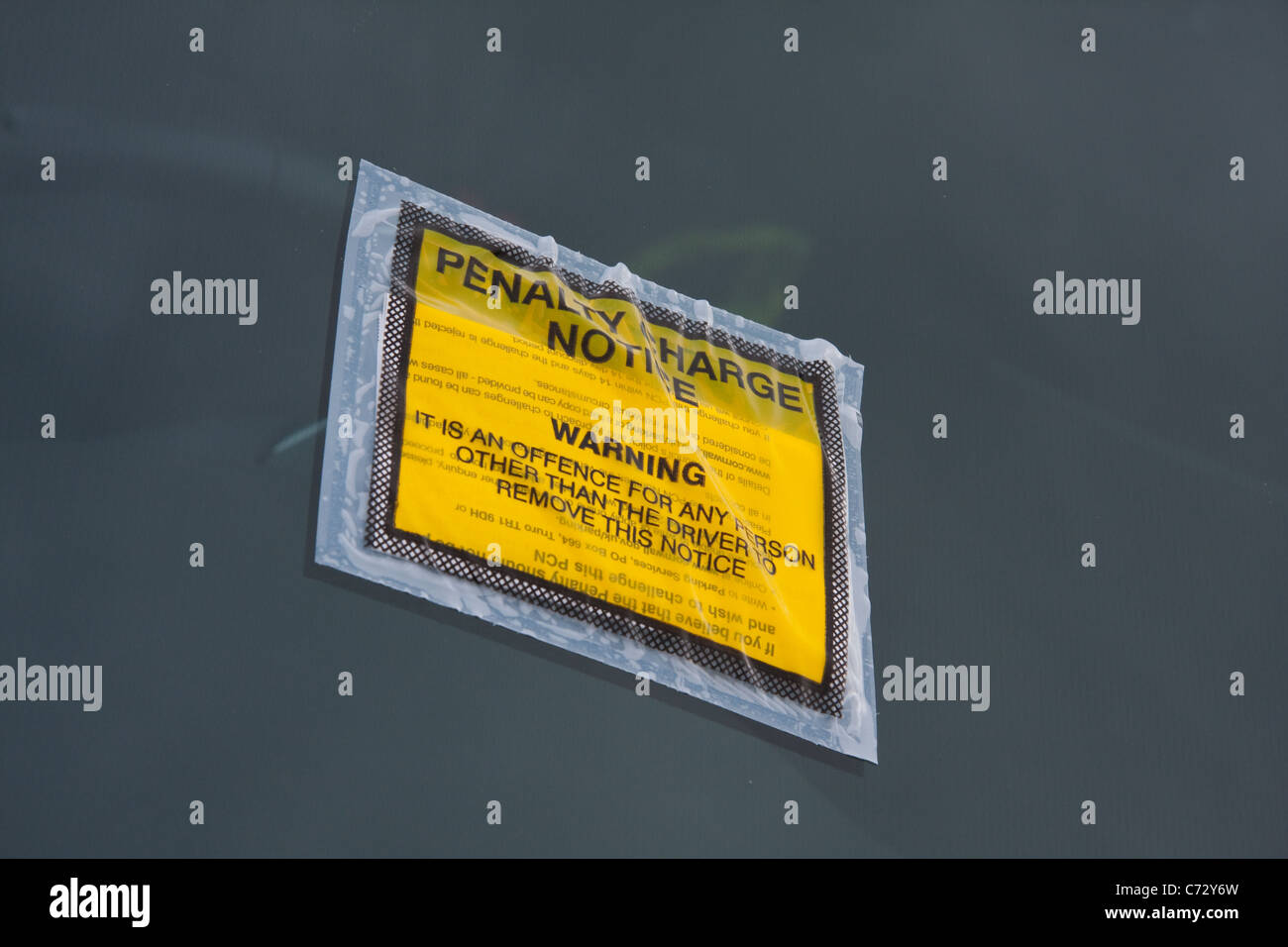 Penalty Charge Notice fixed to windscreen of car - Stock Image