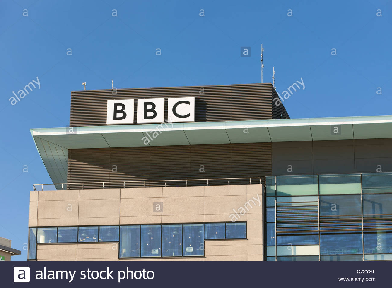 BBC sign at the BBC Manchester office at MediaCityUK, Salford, Manchester, England - Stock Image