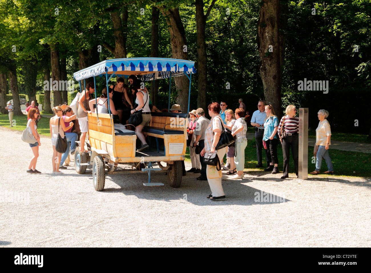 Tourists boarding a horse carriage, Herrenchiemsee Herreninsel Upper Bavaria Germany - Stock Image