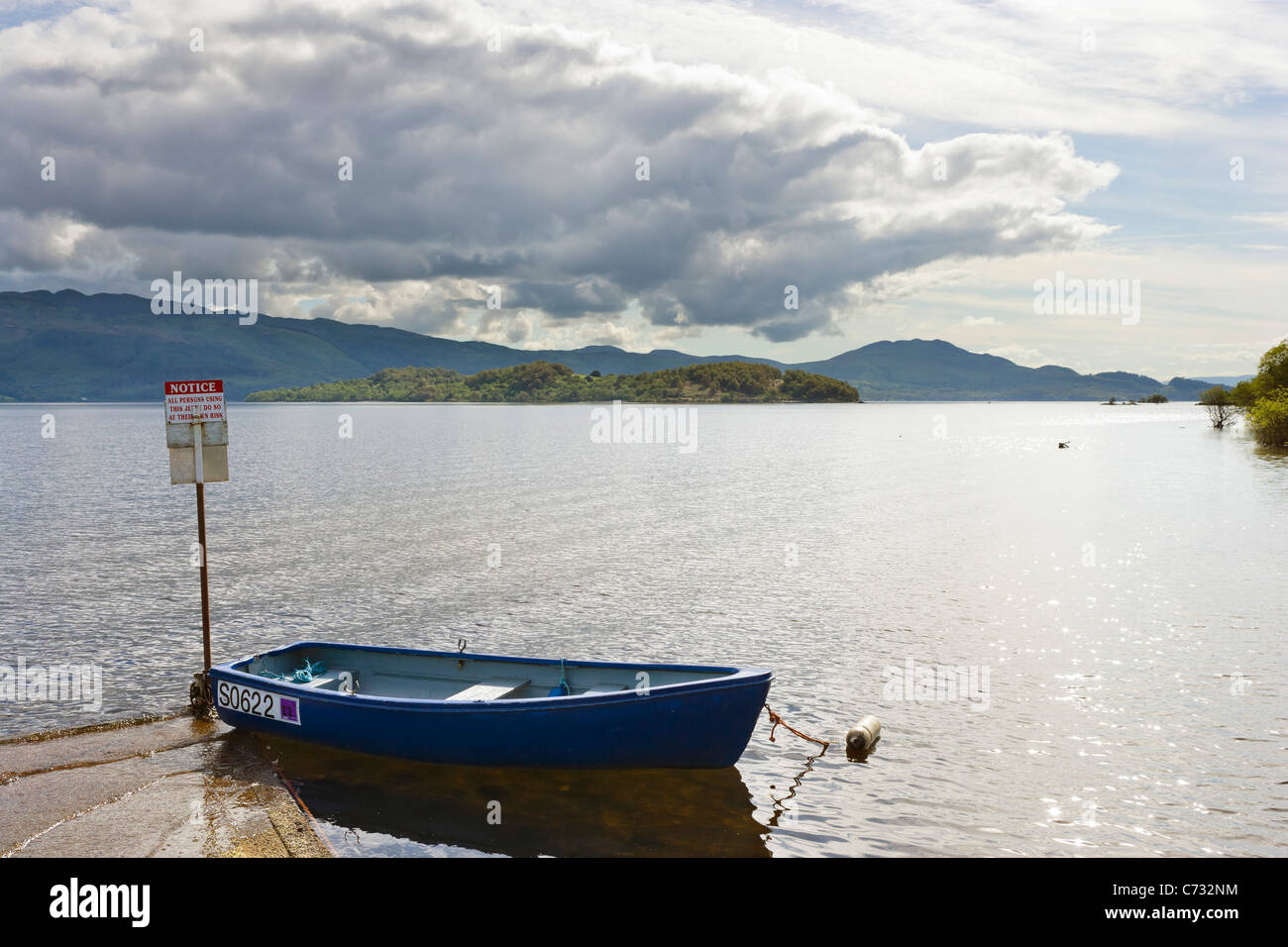 View over the loch from Luss on the west bank of Loch Lomond, Argyll and Bute, Scotland, UK - Stock Image