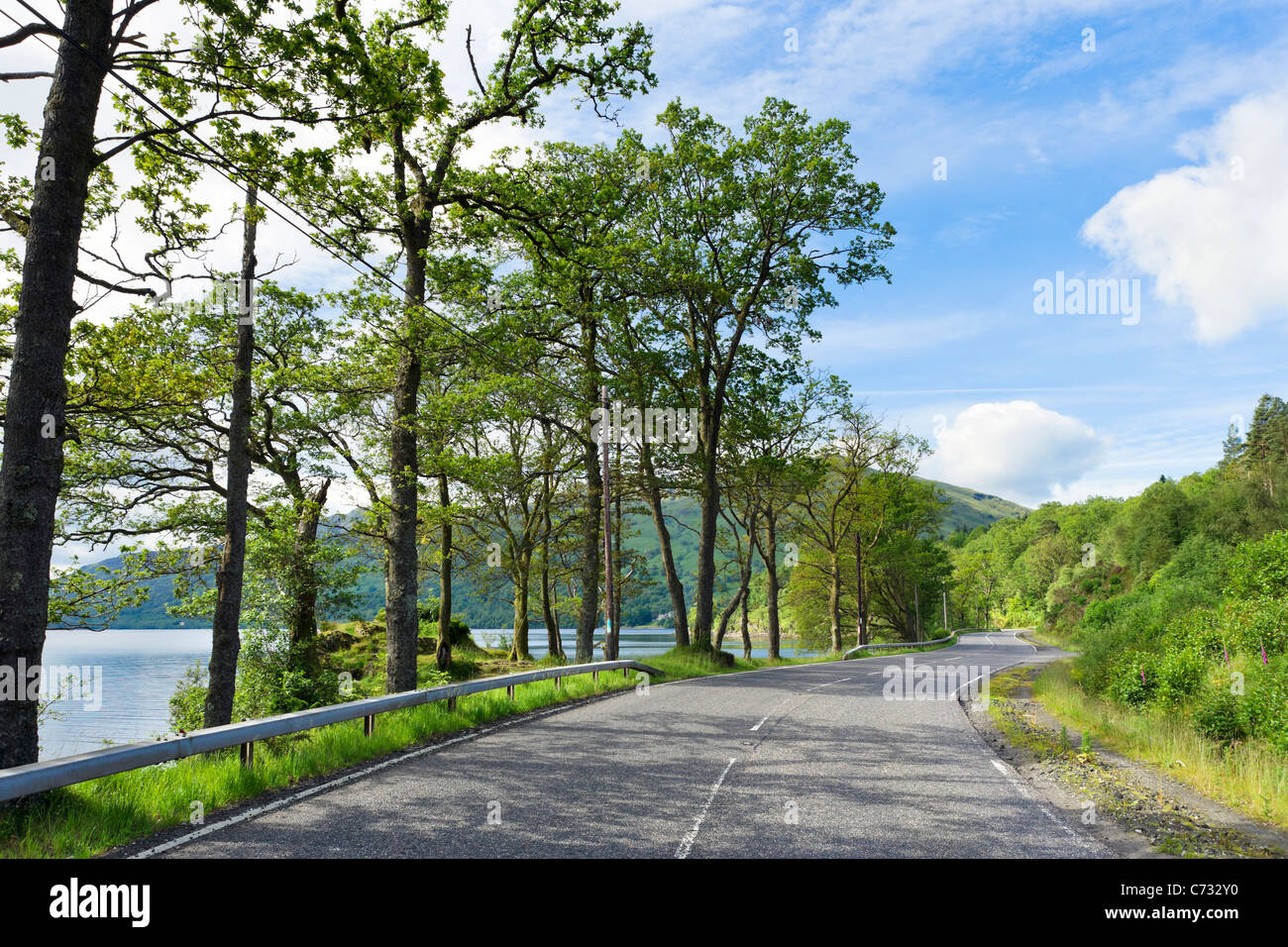 The A82 north of Luss on the west bank of Loch Lomond, Argyll and Bute, Scotland, UK - Stock Image