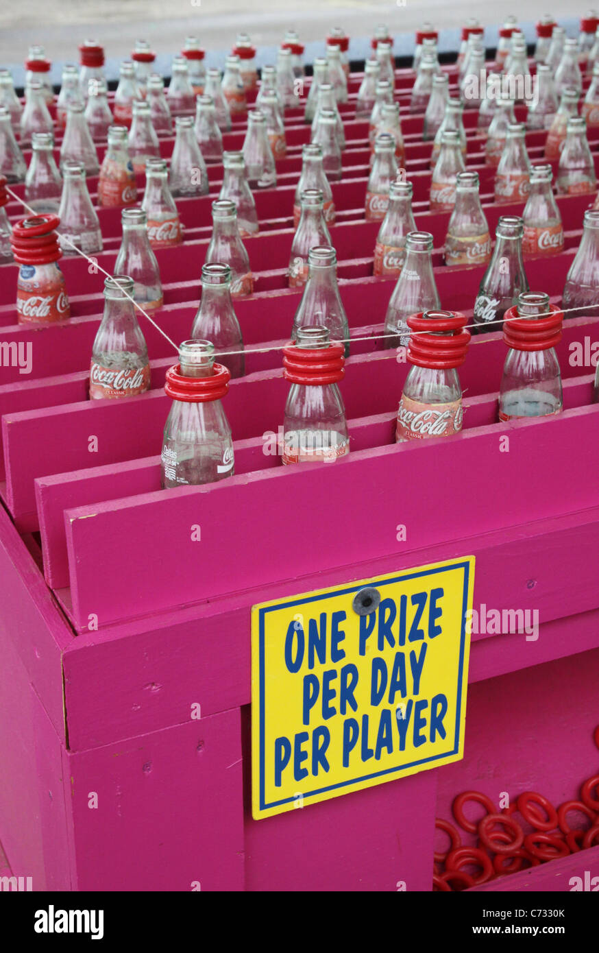A carnival ring toss game. - Stock Image
