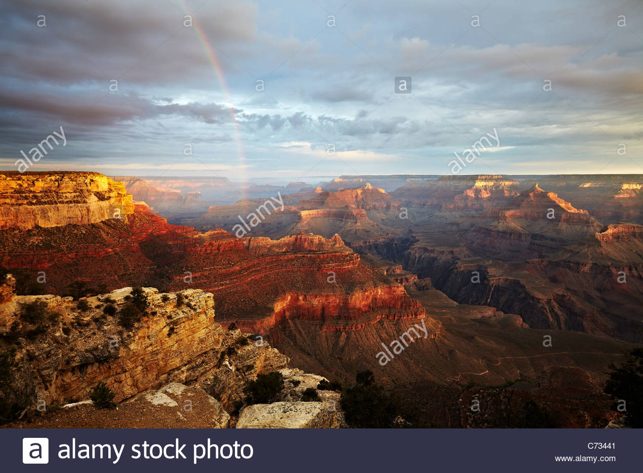 The sunrise, morning light and rainbow across the Grand Canyon, Arizona, USA - Stock Image