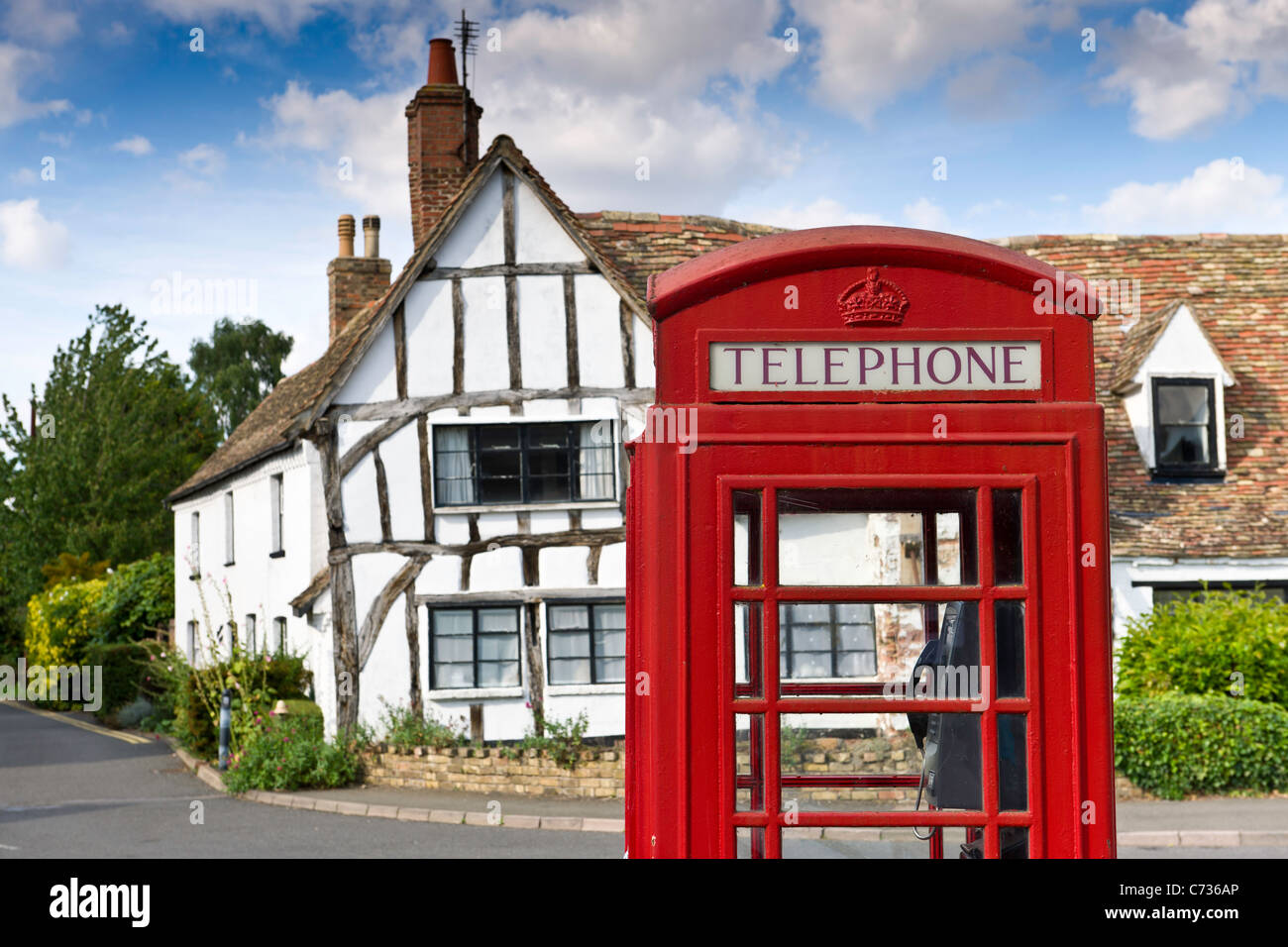 A traditional English Village red Telephone Box - Stock Image
